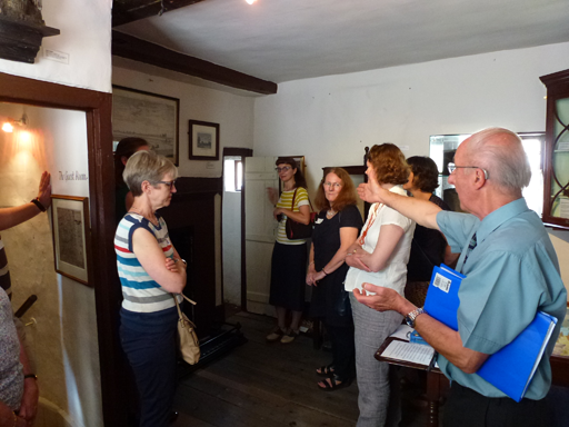 Volunteer John taking the group on a tour of the Museum of Cambridge