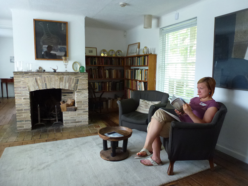 Inside Kettle's Yard. SEMF member Lauren is sitting on an armchair